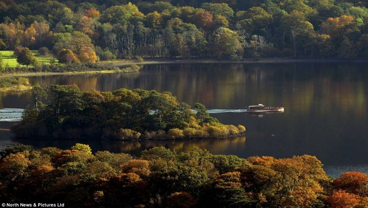 Seasonal splendour: Derwentwater is surrounded on all sides by shades of green, russet, copper and gold