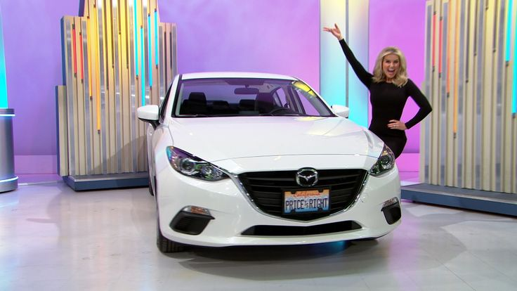 It's the 2016 Mazda 3 i Sport Sedan, featuring a 2-liter engine, 6-Speed automatic transmission, and rear view camera.