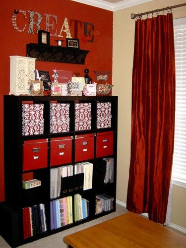 Craft room storage Ikea Expedit One red wall. I like the coordination