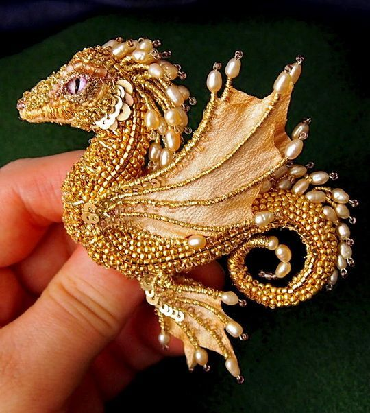 Alena Litvin is talantet bead artist from Russia. She makes pretty brooches with cute little dragons. They are really unique and one of a kind. Every dragon has its own face and character.