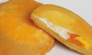 """Arepa filled with egg (""""Arepa de huevo""""). Visit our website: http://www.going2colombia.com/"""