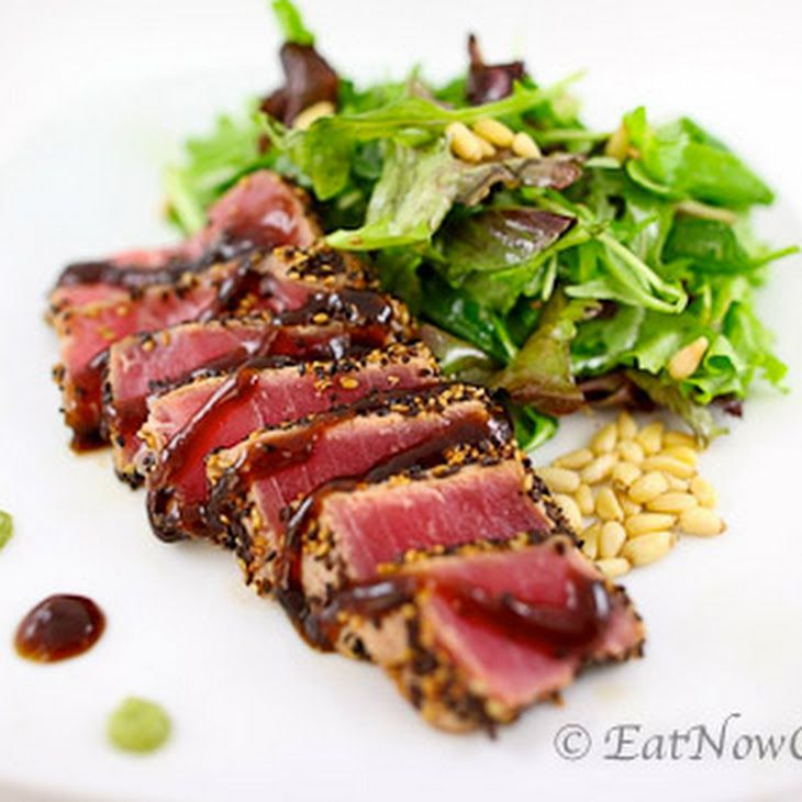 Pan Seared Ahi Tuna Recipe with ahi tuna steaks, sesame oil, marinade, white sesame seeds, water, ginger, soy sauce, hoisin sauce, salt, brown sugar, black pepper, corn starch, salad, pinenuts, wasabi paste, extra-virgin olive oil, apple cider vinegar, lemon, orange juice, sesame oil, hot mustard, salt, pepper