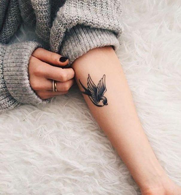 sparrow tattoo on arm