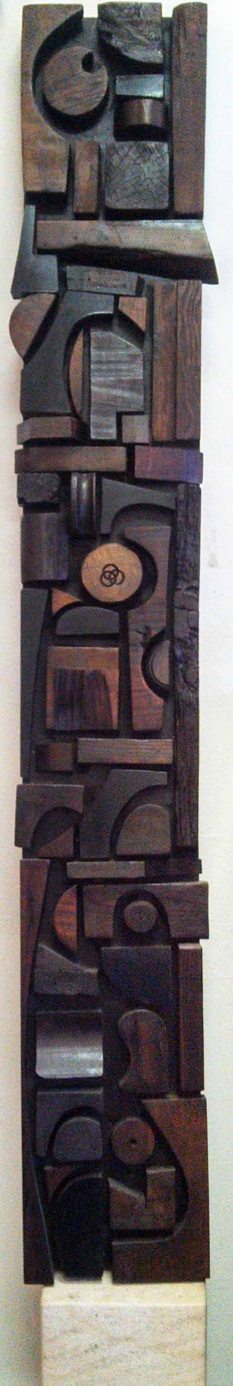 Wood Assemblage Panel by artist Mabel Hutchinson.  Inspired by an exhibit of the work of Louise Nevelson, Mabel began to build her own assemblages from the wood scraps from her husband's wood shop.  Her panels and doors can be found in museum and private collections.