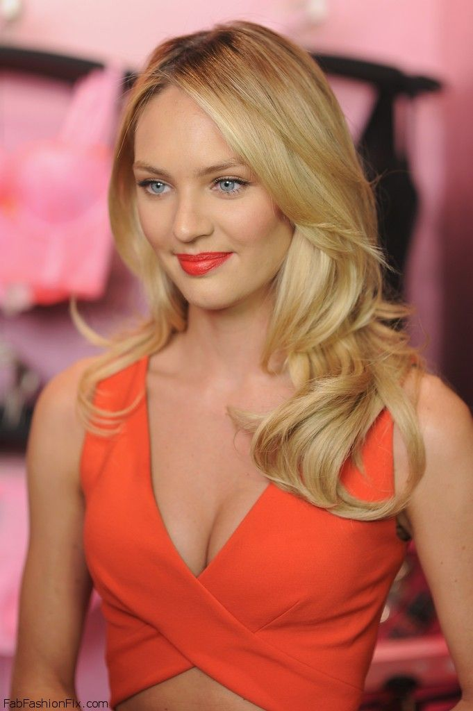 Gorgeous #Candice Swanepoel with bright orange lipstick and long layered hairstyle