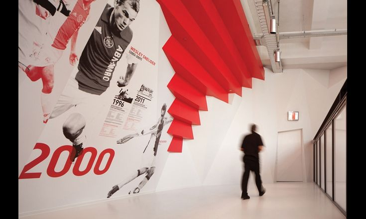 The museum entrance, called History Hall, maximizes soaring 26-foot-high walls and ample natural light to highlight the team's history, timeline, and titanic soccer players from past to present. #SEGD
