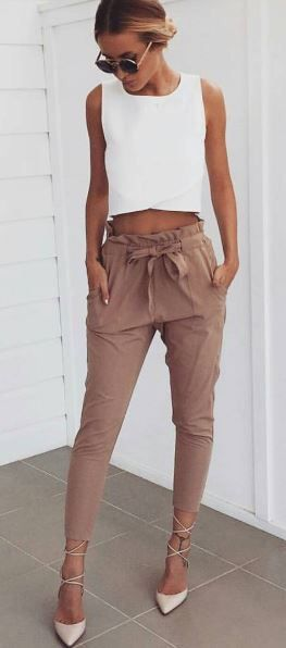 Cute beige linen joggers high waisted with white tank and up do strappy heels