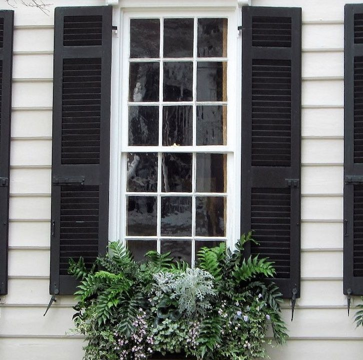 The Color Charleston Green A Popular Paint Color On Historic Homes In Charleston Sc Is Mostly Black Paint W House Shutters Shutters Exterior Shutter Colors