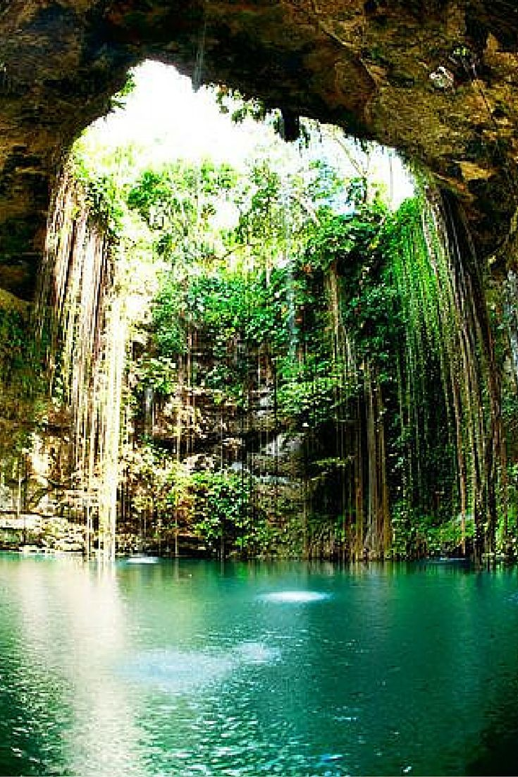 20 UNREAL Travel Destinations!  A cenote is a sinkhole that fills up with water.  Ik Kil is a cenote in Mexico that the Mayans used to use for rituals.  I can understand getting a sense of spiritual power here.