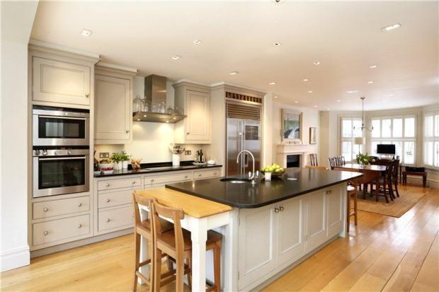 white cupboards, black granite, pale oak floor