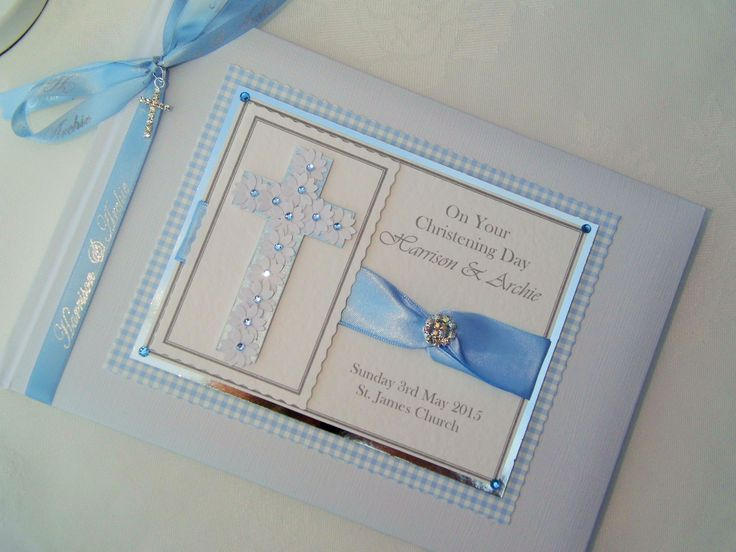 Handcrafted baby boys Christening guest book in a baby blue theme. Beautiful ornate cross to the centre with diamante embellishments