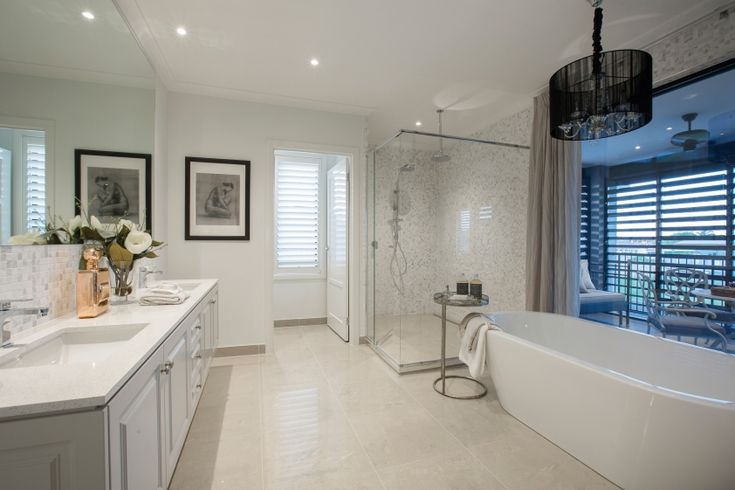 Escape to your own piece of Paris in this glamorous ensuite. Feature lighting piece gives the space an edge whilst the light and fresh colour palette provides softness.