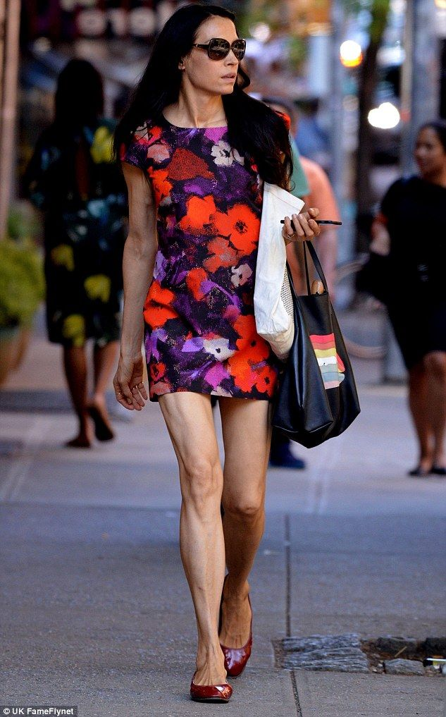 Famke Janssen flaunts her endless legs and toned body in floral mini dress as she takes a stroll in New York City | Daily Mail Online