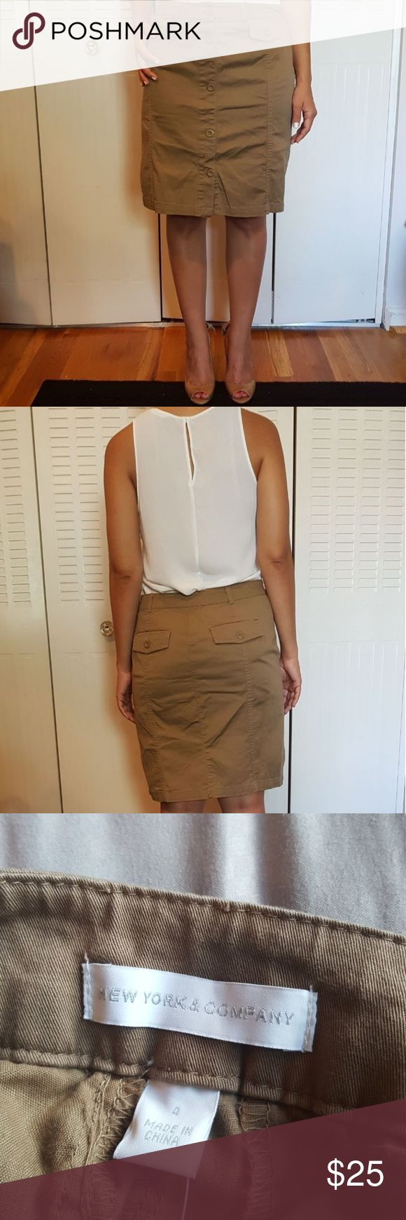 Khaki pencil skirt Skirt is safari inspired. Hits right at the knee. New York & Company Skirts