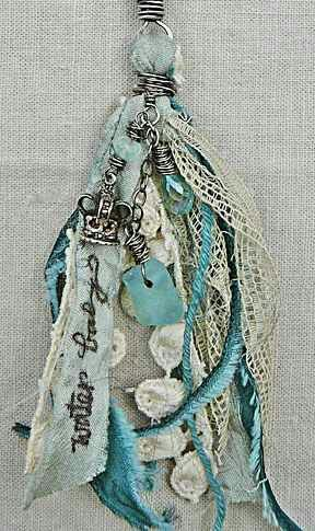Tassles made from cloth, lace, feathers, and buttons.