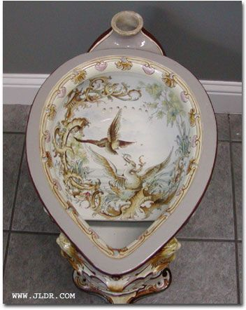 Victorian Porcelain Toilet presents proper dignity to the pooping process.