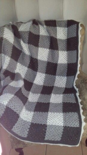 Grey and white crocheted granny square blanket
