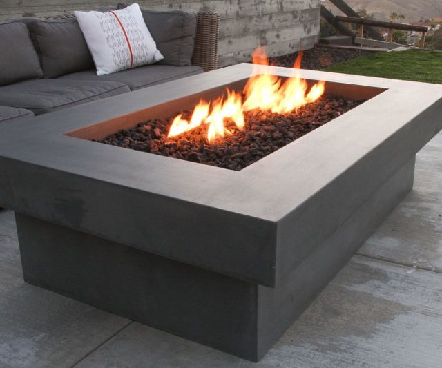 Make your patio the place to be by gathering everyone around the Olson concrete fire pit table. Handcrafted from concrete and steel, the center comes filled with lava rocks you can light up using natural gas, while the wide edges offer the ideal place to rest your drink.