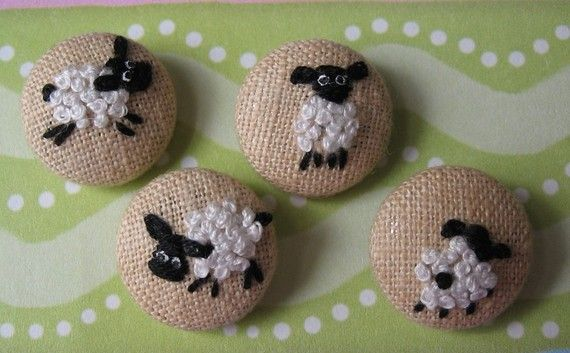 think these are by Lorna Bateman.  Embroidered Sheep - Fabric Covered Buttons or birds or whatever, cute