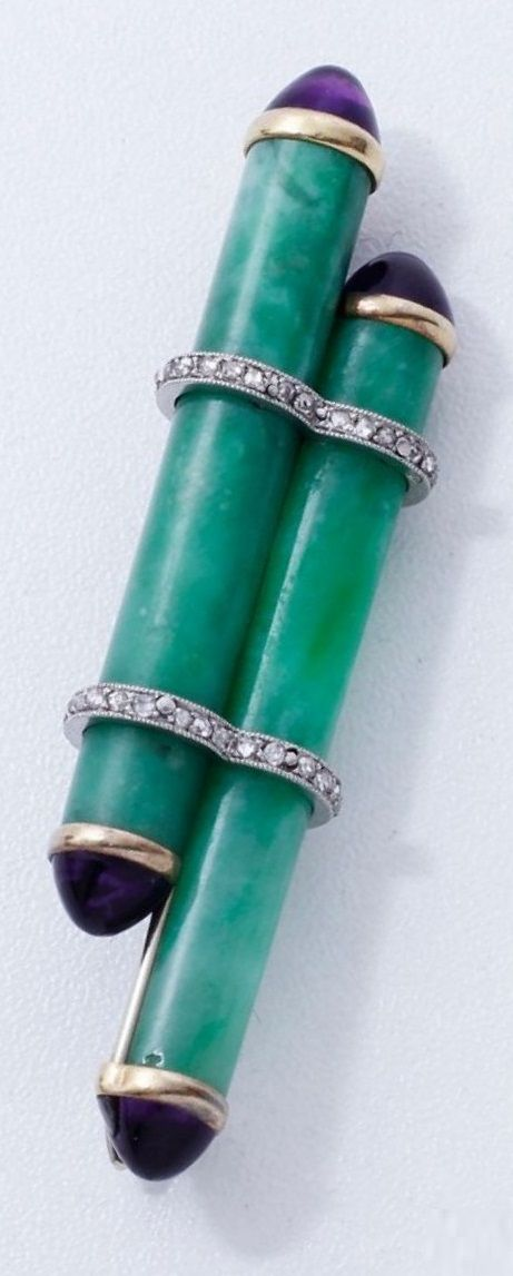 Cartier - An Art Deco gold, platinum, jadeite, diamond and amethyst brooch, circa 1930. Signed CARTIER Paris, London, New York, and numbered. 6.3cm long. #Cartier #ArtDeco