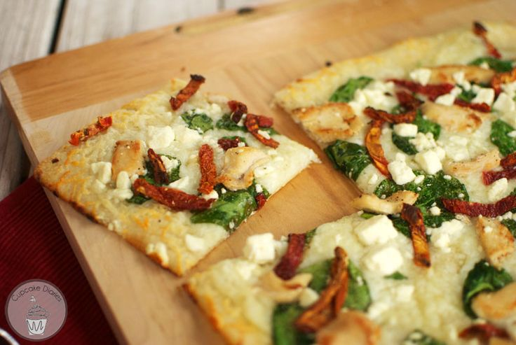 White Pizza, make changes.....replace feta with some other cheese. I would add some bacon and onion, no tomato.