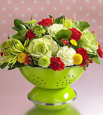 Colander As A Vase ~ fun Idea... a great housewarming gift, as the colander can be used in the kitchen once the arrangement falls... love the Kelly Green Colander!