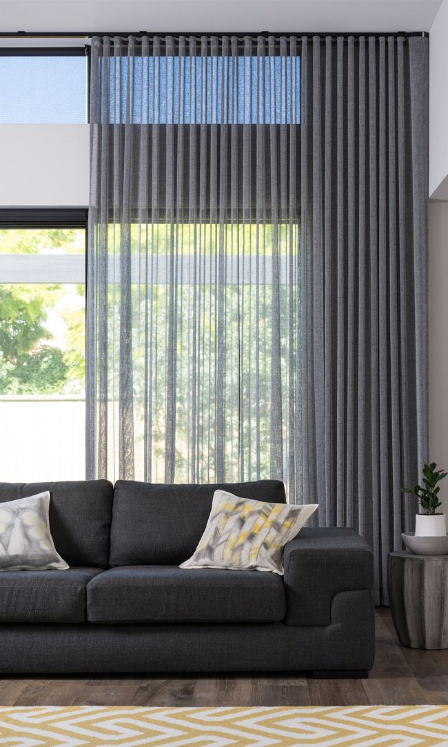 Dark Sheer S Fold curtains with dark ceiling mounted track