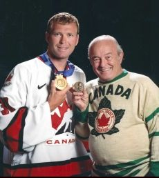 Marty Brodeur with his 2002 Olympic gold poses with dad Denis and his 1956 Olympic bronze. They are the only father-son goalie duo to win Olympic medals to date.