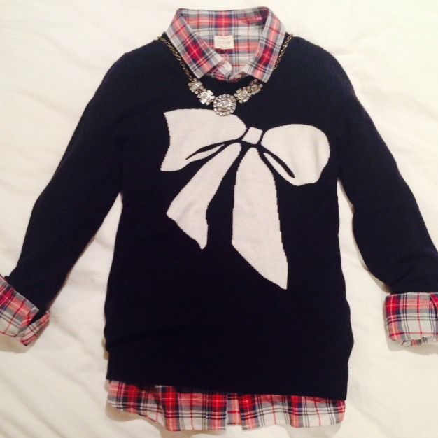 Love the combination of the tartan button up with the bow sweater. Must recreate.