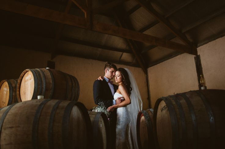 Tucked away in this winery was this moody cellar with splashes of light seeping through the wine barrels... Check out Marique and Stefans Wedding blog. #melourneweddings #weddingphotography #bridal #melbournebrides #mottaweddings