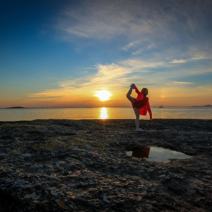 My daughter doing her acrobatics during sunset  by liv_annette