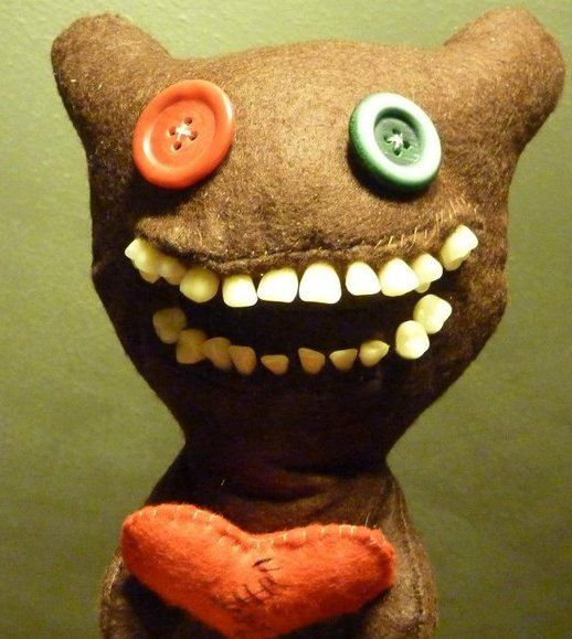 "So fantastically creepy, a Etsy store that makes plush ""toys"" using artificial human teeth."