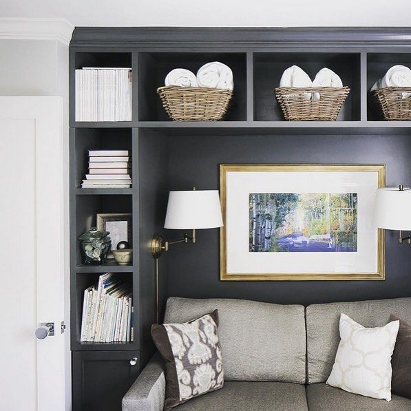 Can we just say how much we love this wrap around shelving designed by @natefischer? We especially love how he included swing arm sconces inside for lighting. Makes us want to cuddle up with a blanket and a book! #mypotterybarn