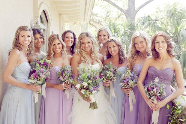 There's something I like about this mix of lavender, purple, and light blue for the bridesmaid dresses. I also love the wildflower bouquets! <3