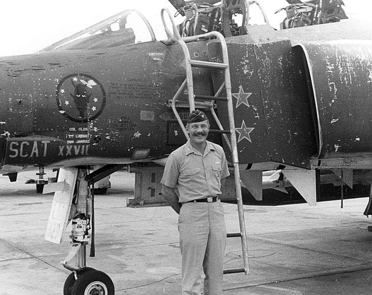 U.S. Air Force Colonel Robin Olds in front of his McDonnell Douglas F-4C Phantom…