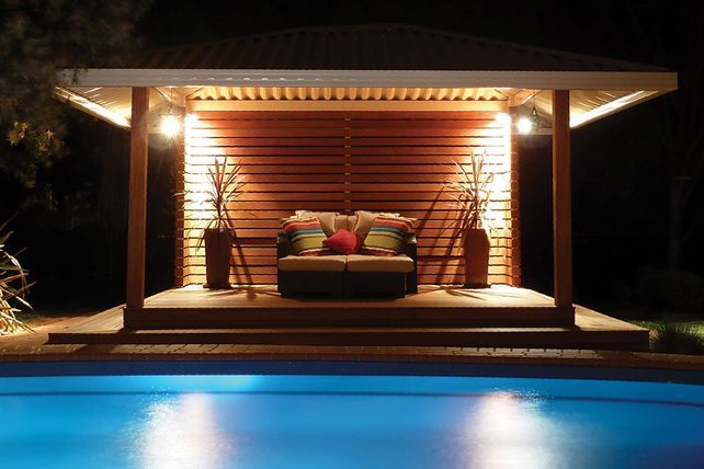 A beautiful and durable gazebo roofing, styled with an outdoor lounge and colourful cushions #summer #night #outdoor #gazebo #roofing #pool #Australia