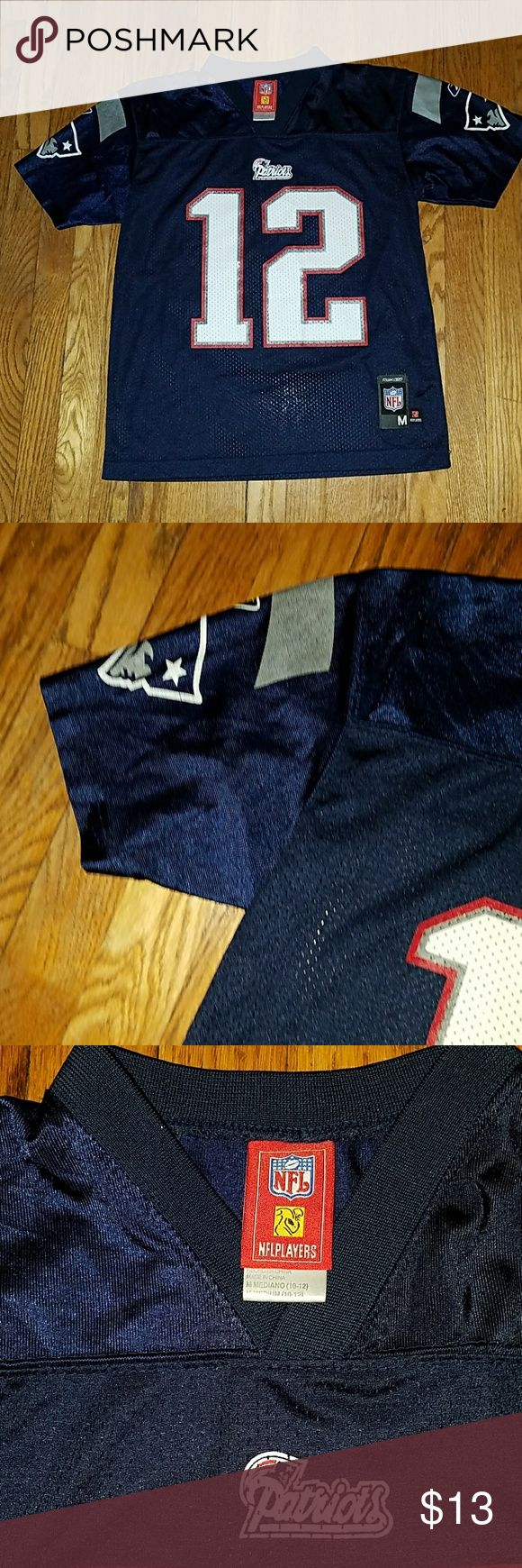 Tom Brady NFL jersey Size is M in kids (10-12) but fits a size S woman. Worn a few times and the some of the name and number is rubbing off. nfl Tops