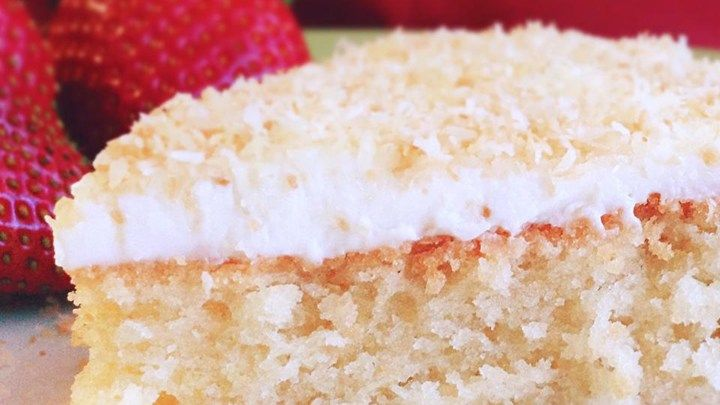Gluten-free coconut cake with walnuts gets a double dose of coconut from flaked coconut and coconut milk added to the batter. Frost with a simple vanilla buttercream.