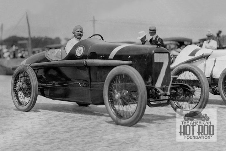 "Louis Chevrolet is seen at Indianapolis way back in 1916. He's in one of the Chevrolet Brother's Frontenac entries. The car was painted maroon with white numbers and powered by a 300"" 4-cylinder engine.   The brothers had entered three cars for the race, numbers 6, 7 and 8. This shot shows Louis in the car wearing number 7 but it actually used the number 8 in the race. His riding mechanic was George Tucker. He qualified in 21st starting position with a speed of 87.69 mph and completed 82…"