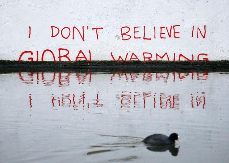 'I don't believe in global warming' by Banksy near the Oval bridge in Camden, north London