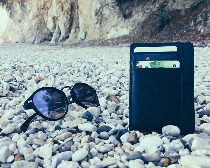 Perfect wallet for the beach.  Add a new Travel Wallet to your beach gear.  #slimwallet #minimalistwallet #frontpocketwallet #thinwallet #rfid #rfidprotection #wallet #blackwallet #giftsformen #mengifts #giftbox #giftset #travelwallet