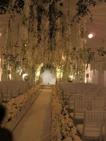 Similar to the Breaking Dawn wedding with hanging wisteria. that looks great.........  https://callthecaterers.co.uk