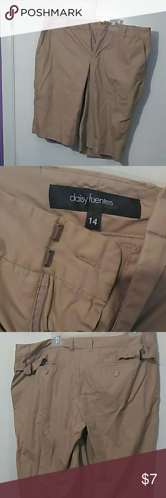 Khaki shorts! Khaki shorts size 14 great condition has side n back pockets. has one button and 2 snaps.  Waist is 17 inches 21 inches long. Prewashed. Ships same or next day excluding Saturdays. I don't trade. I accept reasonable offers and have bundle discounts. Thank you for shopping my closet. Any questions ask. Daisy Fuentes Shorts
