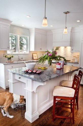 A beautiful kitchen with a simple nook built into the for Beautiful built in kitchens