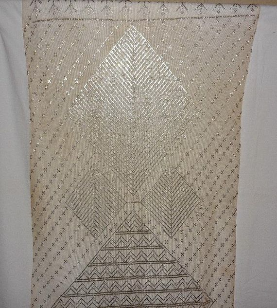 Authentic Antique Egyptian Art Deco Era Shawl excellent sturdy condition - silver plating intact - clean - weighs 14 oz 1920s Flapper Era textile - hand made by Egyptians living in the city of Assyut 80 X 30 white or light ecru cotton netting (tulle) No holes - no stains - no repairs Edges are tightly rolled Geometric designs - lozenges and diamonds Many old Egyptian movies have depicted Belly Dancers performing (raks sharqi) in costumes made from these beautiful textiles. Many Hollywood…