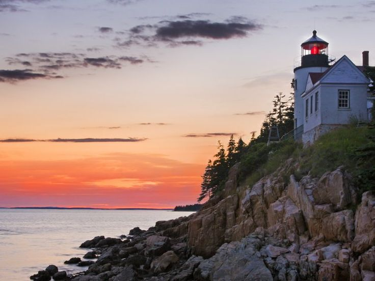 Watch the sunset from Bass Harbor Head Lighthouse in Maine's Acadia National Park.