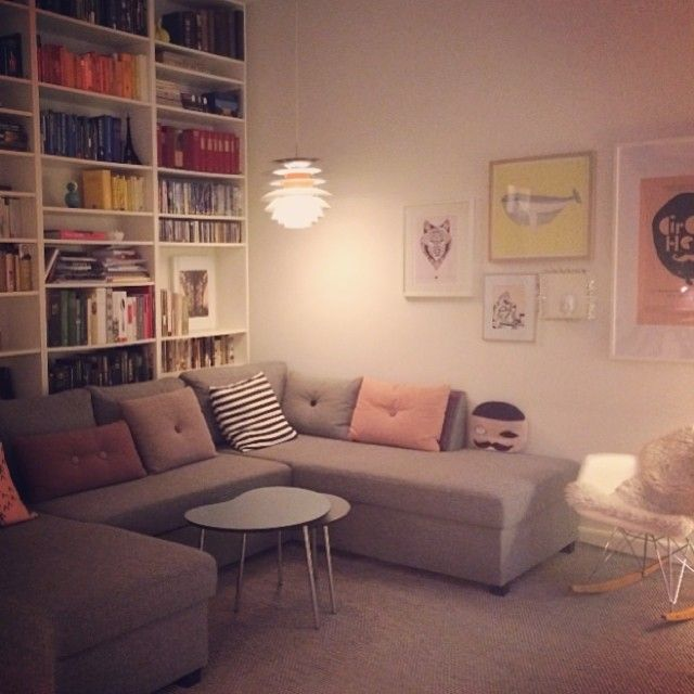 This is beautifully cosy. My cup of tea! Bookshelf with a cosy corner sofa. I love the colours, it makes it seem warm - like you could doze off whilst having your nose stuck in a good book.