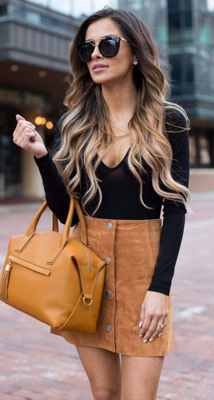 Tan suede mini skirt with black top.