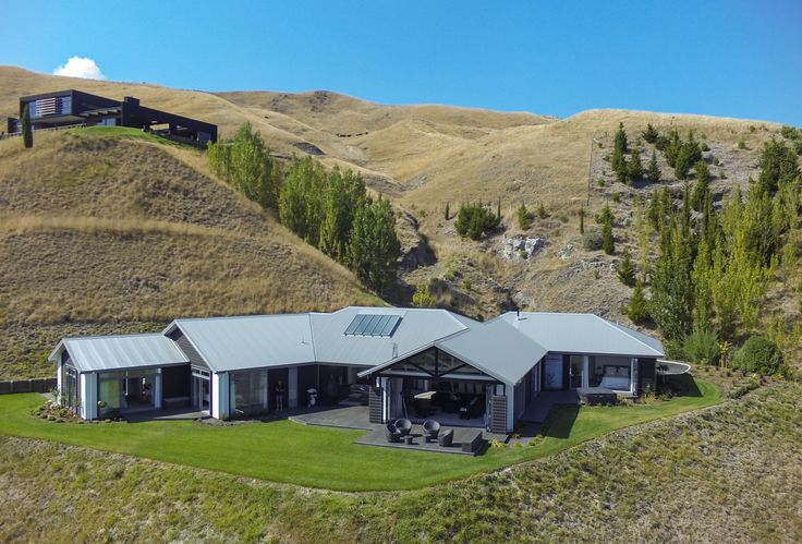 The home was uniquely designed to maximize the use of the site, the building platform was determined by the way it was cut in to the ridge line providing extensive views