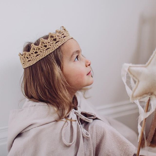 Every woman in this world has a princess soul... This beautiful little girl is wearing Numero74 Leia Cape in powder, 100% Cotton. In her hands she's holding a Numero74 Star Wand, powder color.